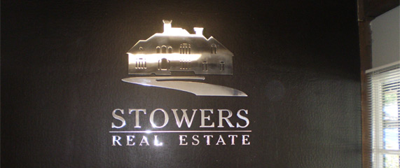 Real estate company reception sign